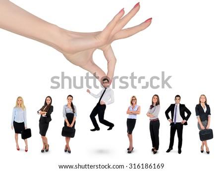 Woman hand choosing business man - stock photo