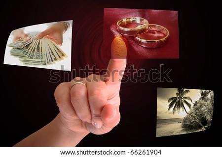 Woman hand choosing wedding rings - all pictures are coming from my gallery - stock photo