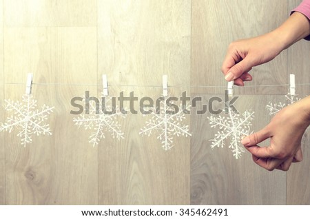Woman hand creating christmas decoration indoor - stock photo