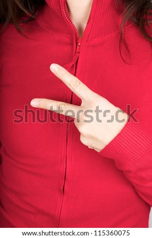 woman hand detail gesturing with two fingers - stock photo