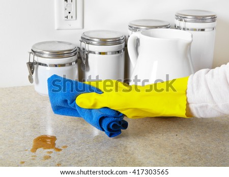 Woman hand doing chores in the kitchen at home , cleaning dinner table - stock photo