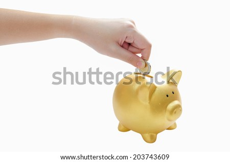 woman hand dropping a coin into a piggy bank on white background
