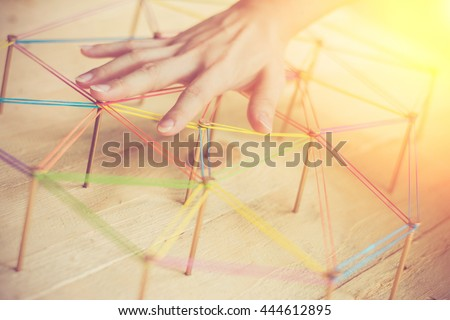 Woman hand engineering control small network concept,Abstract background networking,social media concept, internet communication concept,link concept,on wood background. - stock photo
