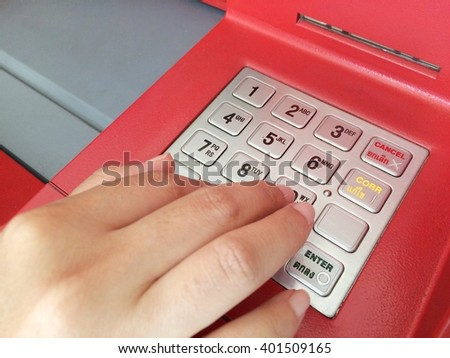 Woman hand enter number on atm machine. - stock photo