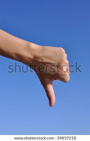 Woman hand, gesturing. Thumb down - stock photo