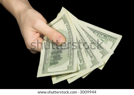 woman hand giving dollars isolated on black - stock photo