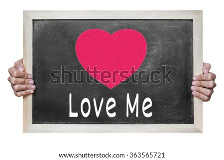 Woman hand hold a red heart and words on blackboard isolated on white background , valentine concept - stock photo