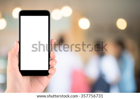 woman hand hold and touch screen smart phone, tablet,cellphone over blurred people background;Transactions by smartphone concept - stock photo
