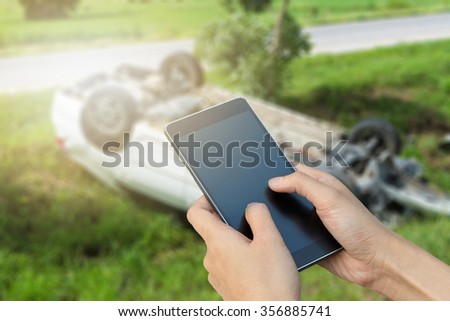 woman hand hold and touch smart phone,cell phone,mobile over blurred image of broken black car : calling mechanic service from repair shop and insurance concept - stock photo
