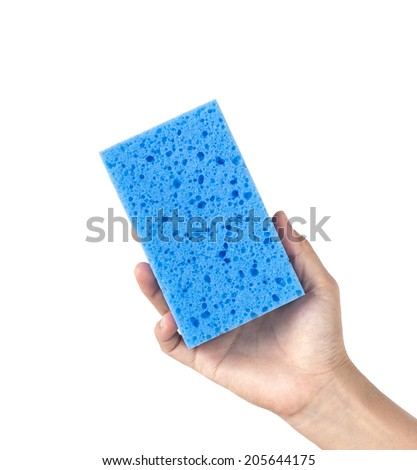 Woman hand holding a cleaning sponge isolated on a white background - stock photo