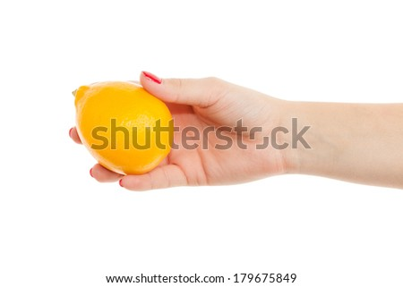 woman hand holding a lemon isolated on a white background  - stock photo
