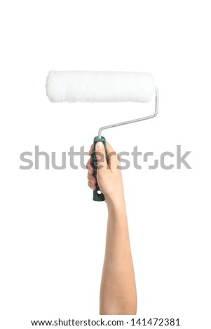 Woman hand holding a paint roller isolated on a white background - stock photo