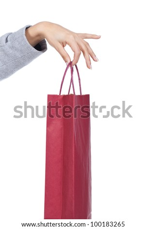 woman hand holding a red shopping bag