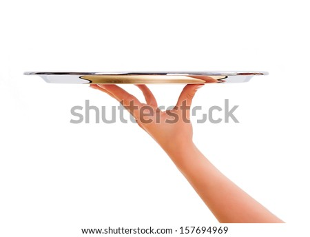 Woman hand holding an empty silver salver - stock photo