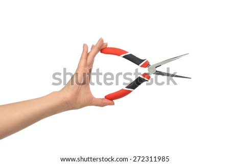 Woman Hand holding big pliers with black and red handles isolated on white background - stock photo