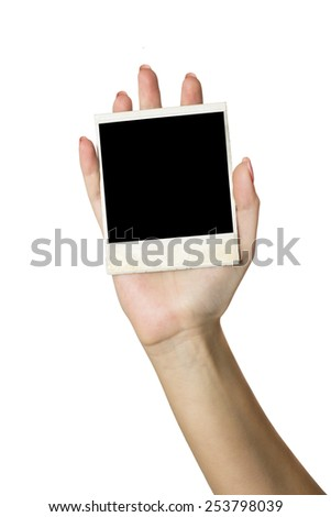 woman hand holding blank instant photo frame, isoletd on white