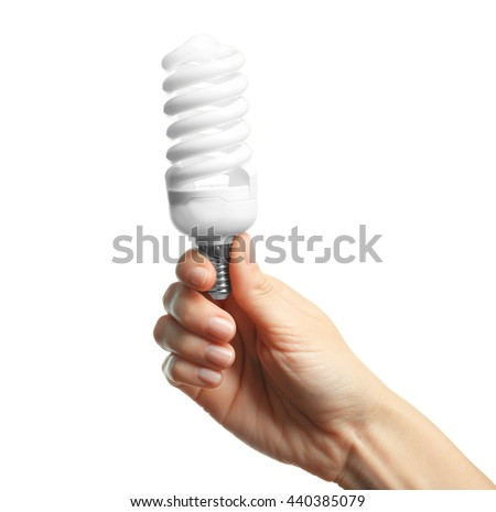 Woman hand holding bulb, isolated on white