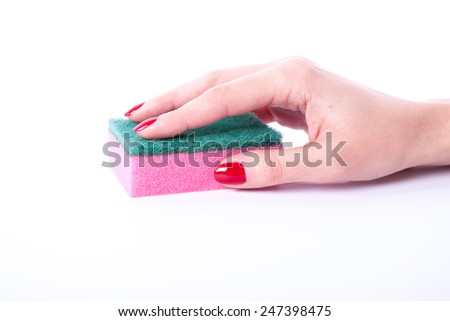 Woman hand holding cleaning sponge isolated on a white background  - stock photo