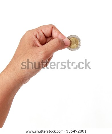 Woman hand holding coin isolates on white background - stock photo