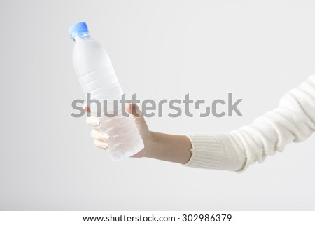 Woman Hand Holding Cold Water Bottle. Concept for Healthy Life - stock photo