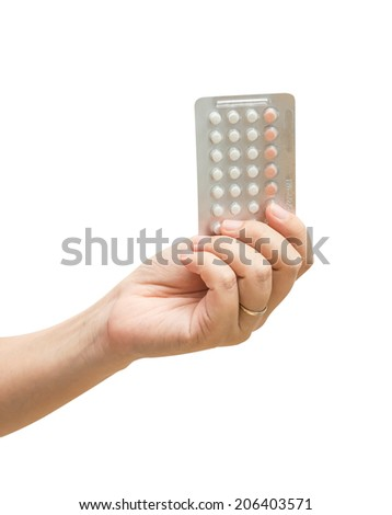 Woman hand holding contraceptives over white background