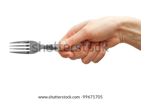 Woman hand holding fork isolated on white - stock photo