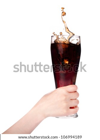 Woman hand holding fresh Cola with ice cubes on a white - stock photo
