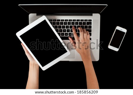 Woman hand holding laptop and working in laptop device - stock photo