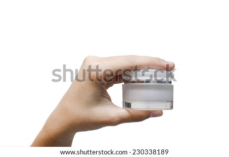 Woman hand holding lotion container on white background