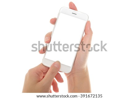 Woman hand holding mobile phone isolated on white - stock photo