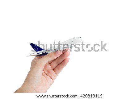 Woman hand holding model airplane, isolated on white background. - stock photo