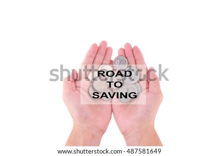 Woman hand holding money with Road To Saving caption. ( Saving concept )