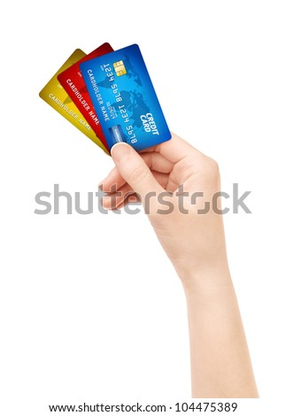 Woman hand holding pack of plastic credit card. Isolated on white. - stock photo
