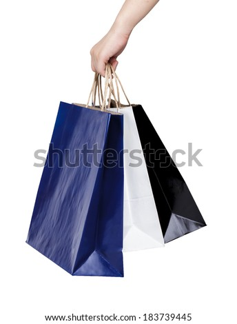 Woman hand holding paper shopping bags isolated on white background