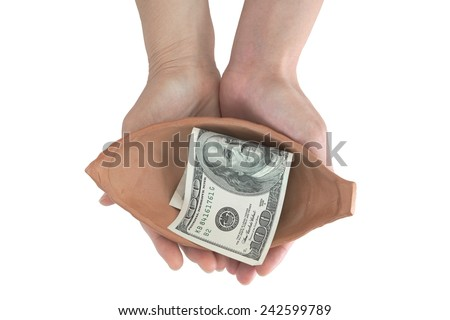 Woman hand holding pottery with single dollar note inside - stock photo