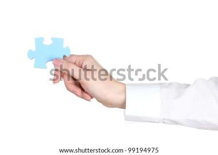 woman hand holding puzzle isolated on white - stock photo