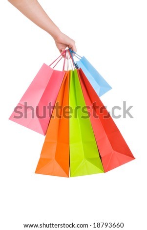 Woman hand holding several shopping bags isolated on white - stock photo