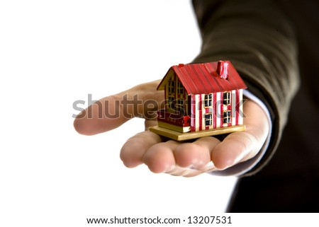 woman hand holding small house - real state concept - stock photo