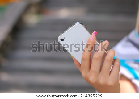 Woman hand holding smartphone