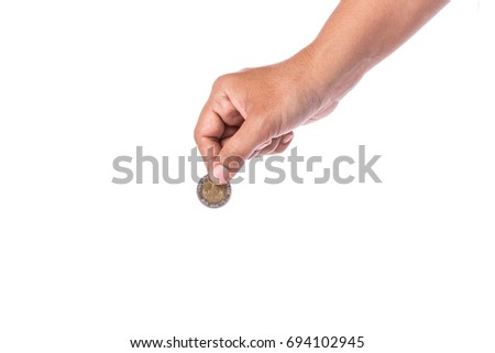 Woman hand holding Thai coin (baht). Studio shot and isolated on white background