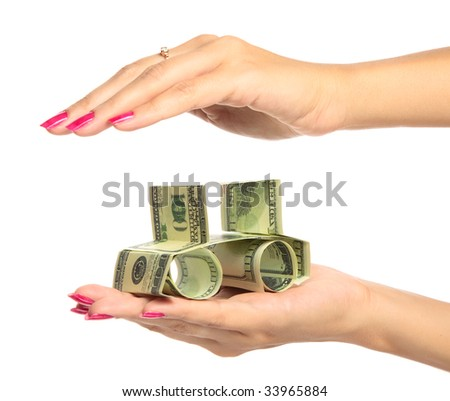 woman hand Holding The car made of Dollars - stock photo