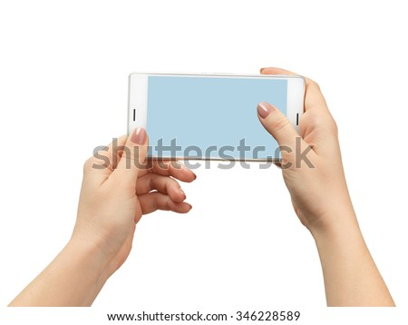 Woman hand holding the white smartphone. Isolated on white background - stock photo