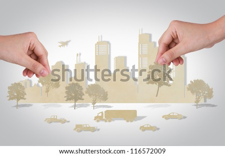 Woman hand holding tree over paper cut of cities with  car and plane - stock photo