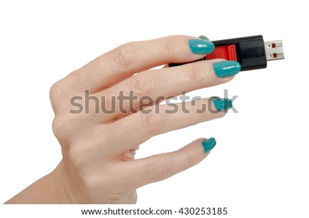 Woman hand holding up a flash drive isolated on a white background - stock photo