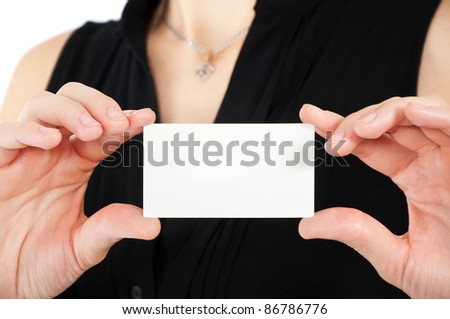 Woman hand holding white empty blank business card, shallow DOF - stock photo