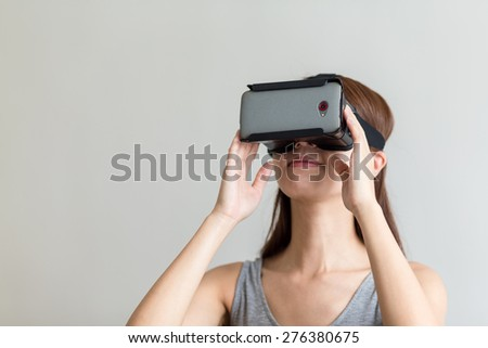 Woman hand holding with VR device - stock photo
