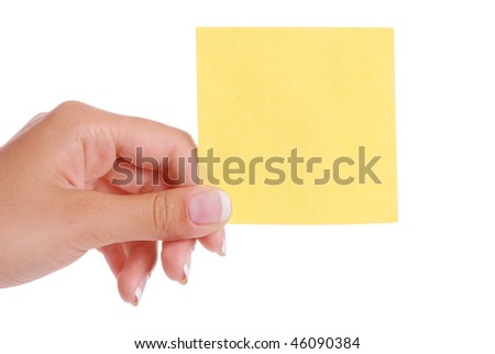 Woman hand holding yellow blank notepaper isolated on white background
