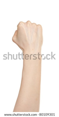 Woman hand in fist isolated on white - stock photo