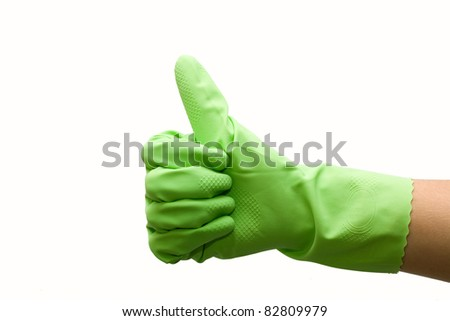 Woman hand in green rubber glove gesturing ok (yes) isolated on white background - stock photo