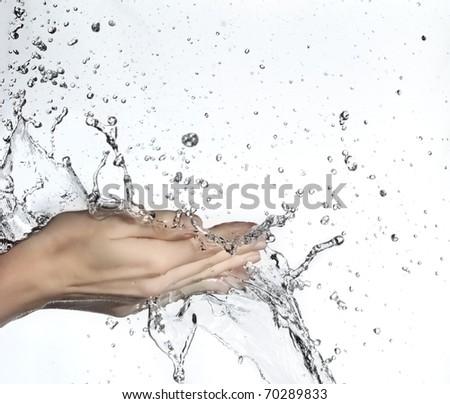 woman hand in water splash - stock photo